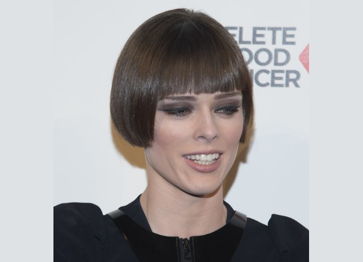 Coco Rocha wearing her hair very short and with a smooth finish
