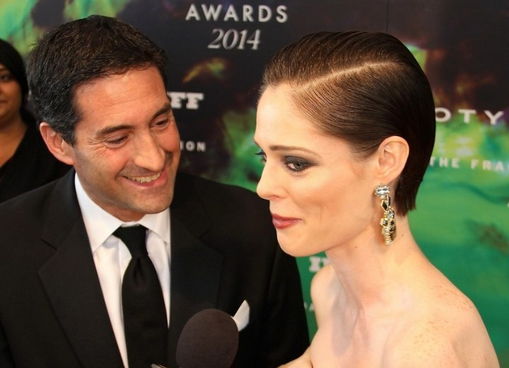 Side view of Coco Rocha's slicked back hair