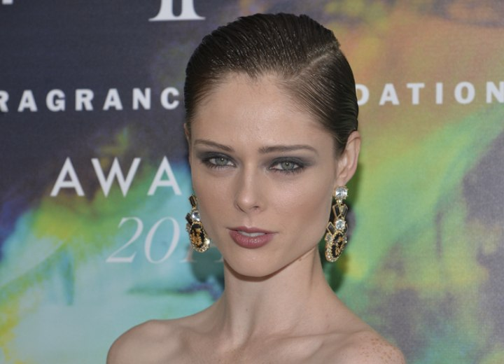 Coco Rocha with her short hair styled for a wet look