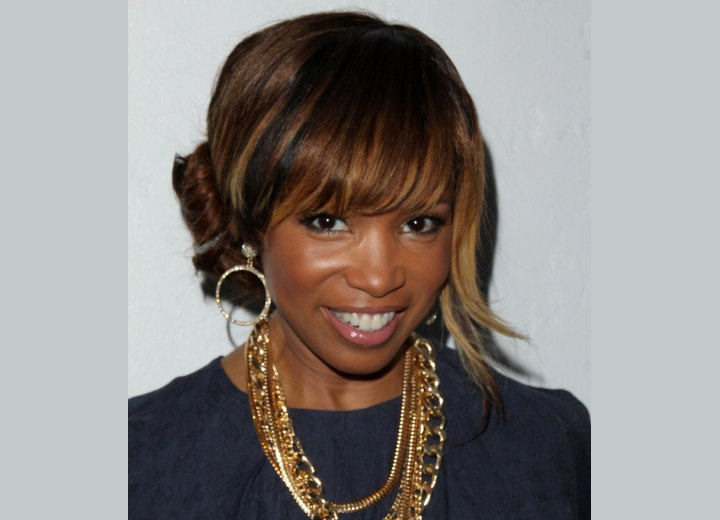 Elise Neal with her hair in an updo with a bun
