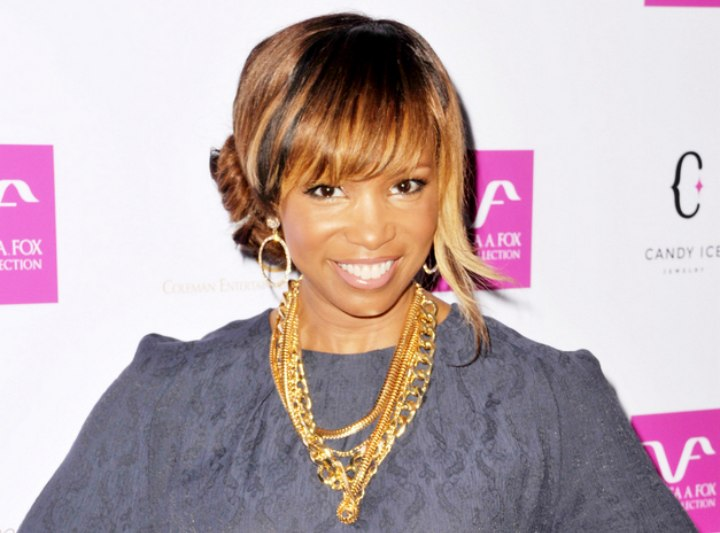Elise Neal with her hair styled up