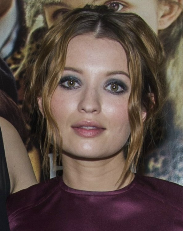Emily Browning Updo With A Low Bun And Loose Pieces Around The Face