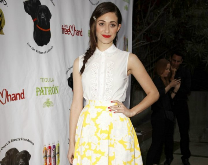 Emmy Rossum's preppy look with a white blouse and a skirt