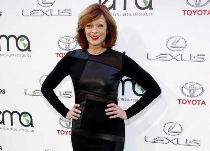 Frances Fisher wearing a dress with leather patches