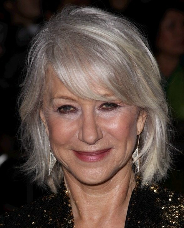 Helen Mirren With Her Silver White Hair In A Style That Touches The