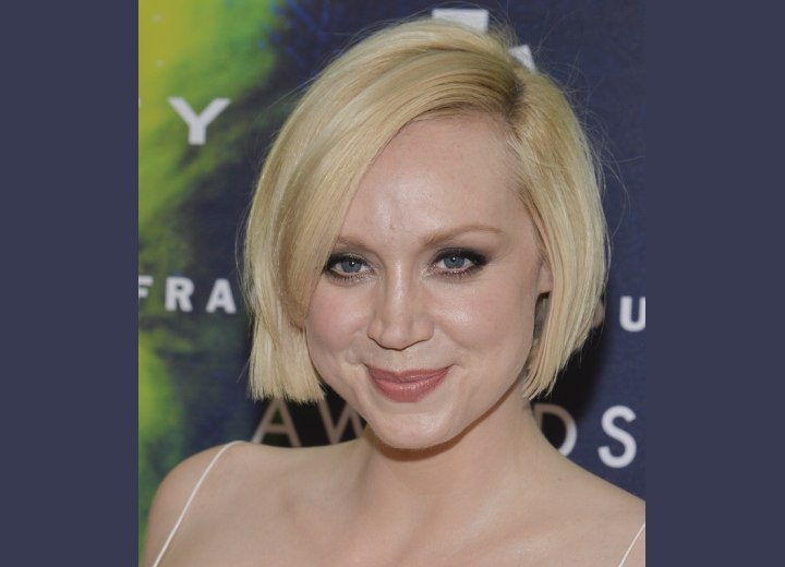 Gwendoline Christie with her hair in a short curved bob