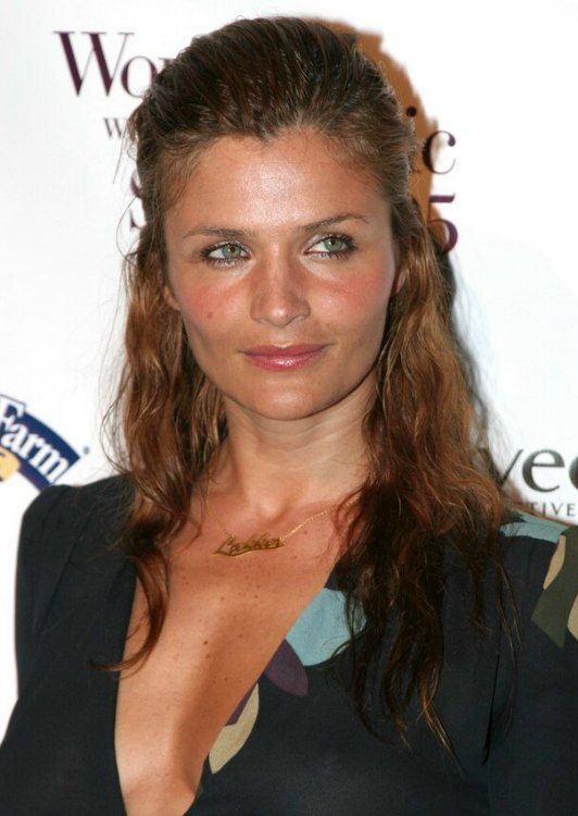 Helena Christensen Wearing Her Hair With Curls And Pulled Back