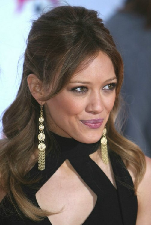Brunette Hilary Duff With Her Hair Pulled Back And Resting