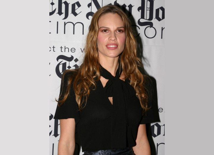 Hilary Swank wearing her hair long with an angled cutting line