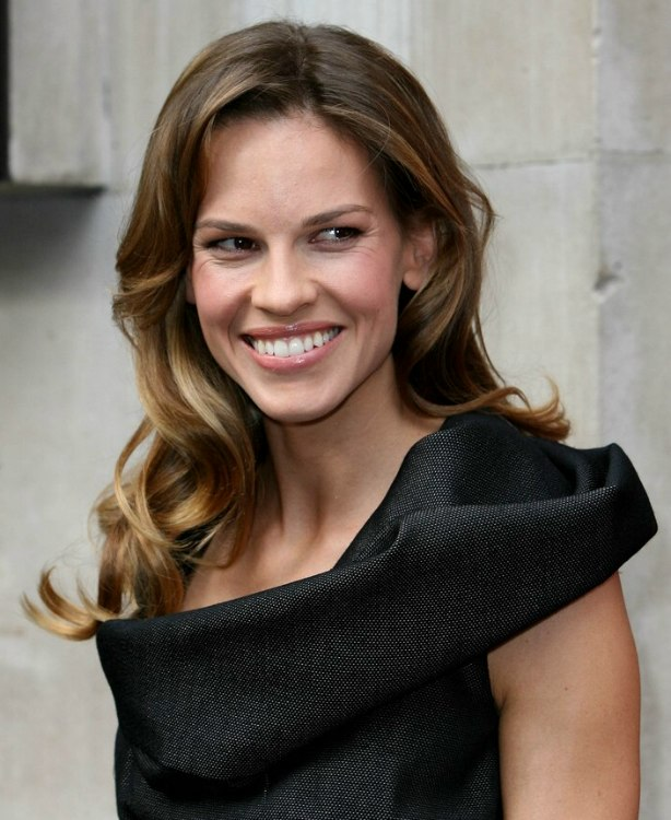 Hilary Swank With Her Long Hair In Curls That Play Around