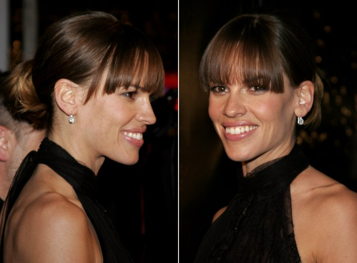 Side view of Hilary Swank's hair with a bun