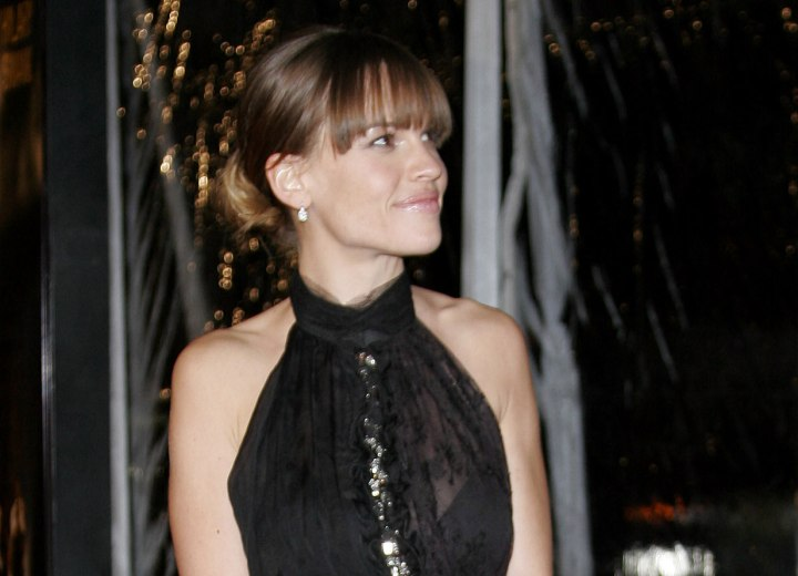 Hilary Swank wearing her hair up with bangs