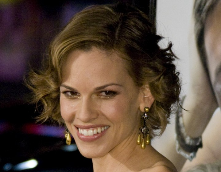 Hilary Swank with short curled hair