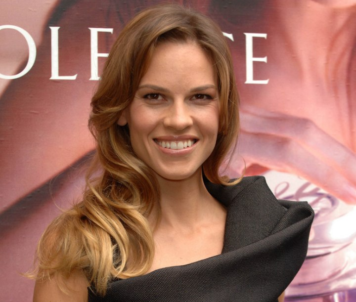 Hilary Swank's hair with curls around her shoulders