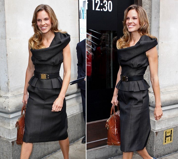 Hilary Swank wearing a fashionable dress with a loose collar