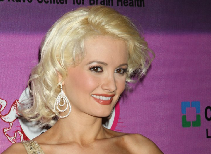 Holly Madison wearing her hair in a curly shag