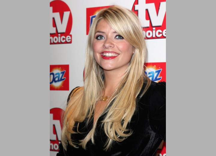 Holly Willoughby's long hairstyle with an off center part