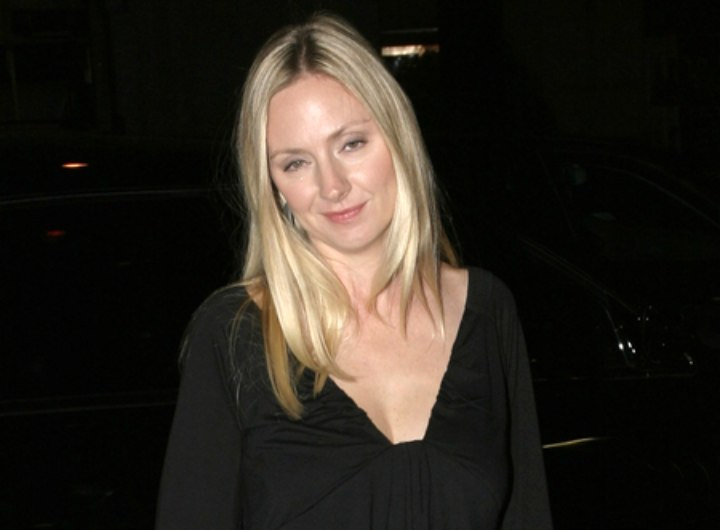 Hope Davis wearing a little black dress
