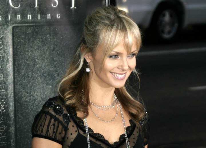 Izabella Scorupco with her hair pinned up