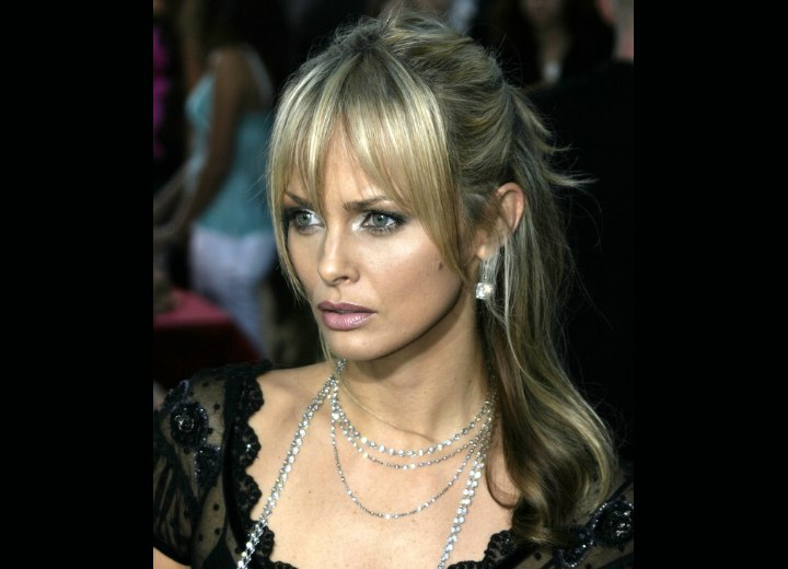 Izabella Scorupco wearing her hair up