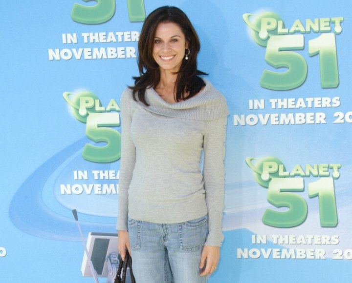 Jennifer Taylor's stylish casual look with jeans and sweater