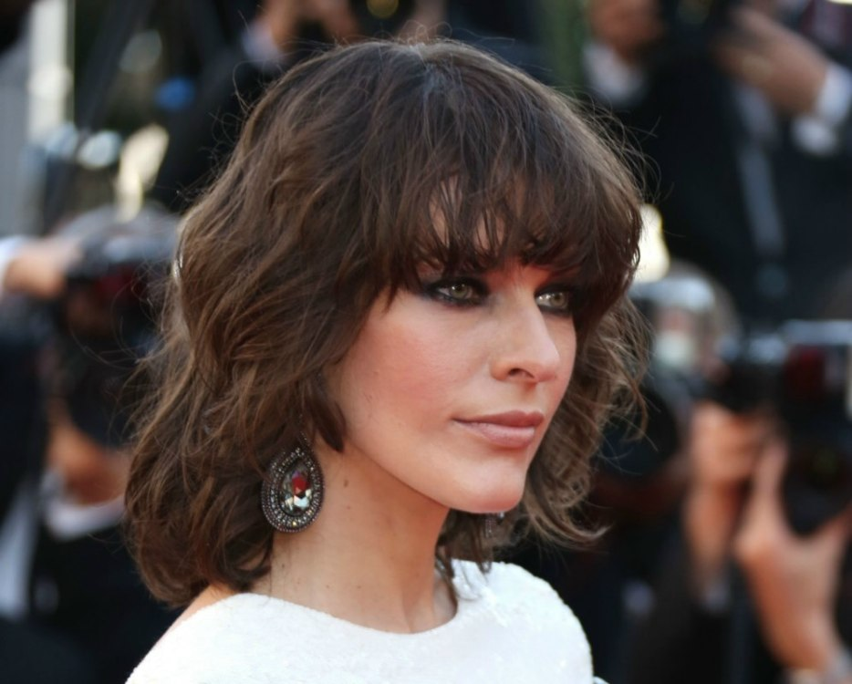 Milla Jovovich Sporting A Fun Mid-length Hairstyle With