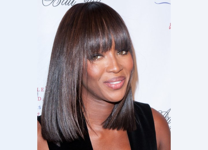 Naomi Campbell with very glossy hair