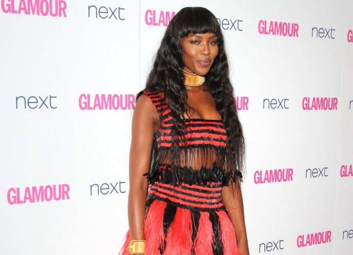 Naomi Campbell's look with very long waved hair