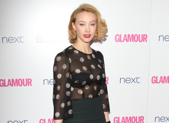 Sarah Gadon with curled hair that looks short