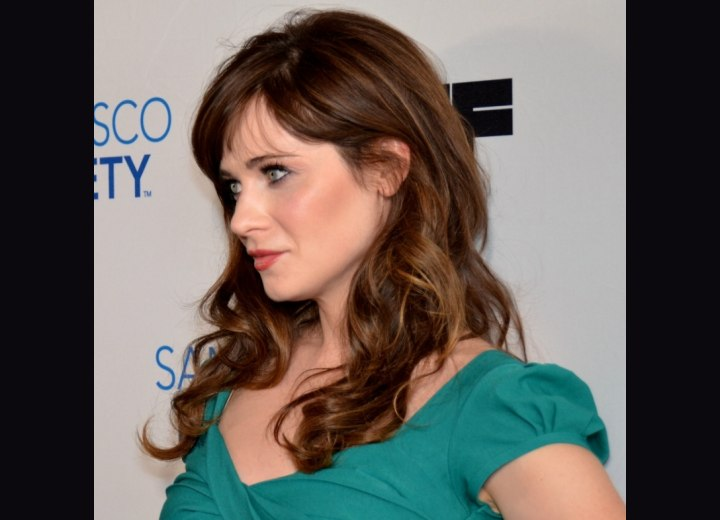 Zooey Deschanel with long curled hair