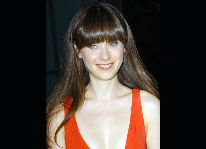 Zooey Deschanel wearing her hair with thick bangs