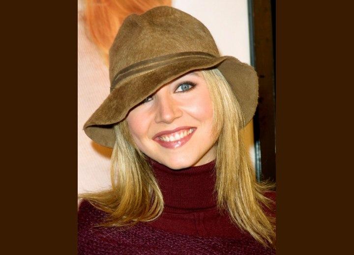 Sarah Chalke wearing a fedora hat