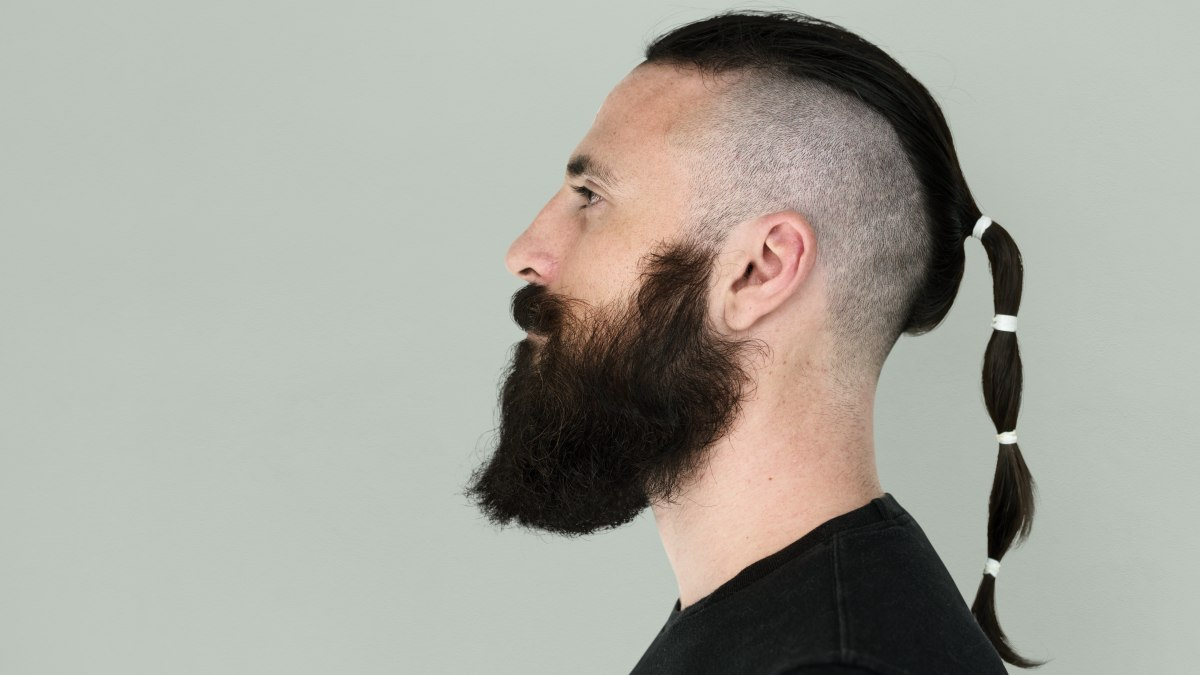 Rat tail hairstyle, a cropped or shaved head with a small long