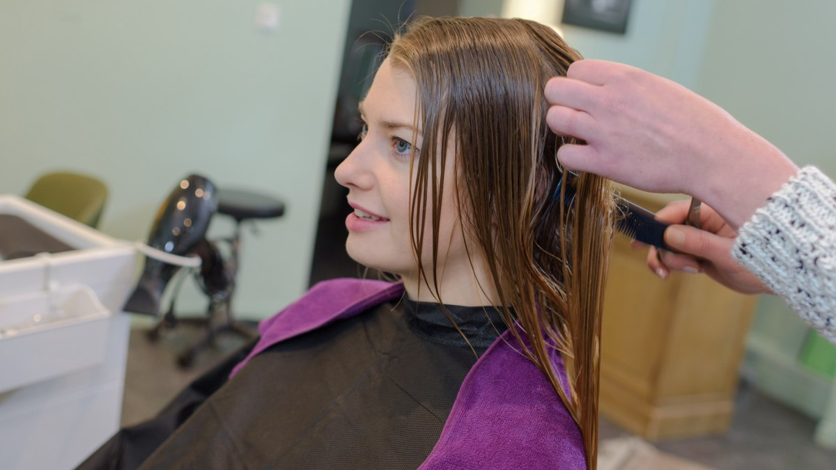 Helix hair cut to enhance the natural wave of hair