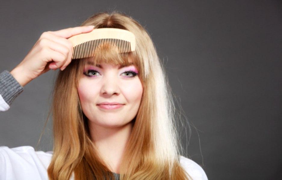 Woman Combing Her Bangs