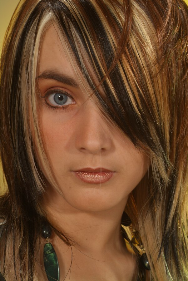 Long Razor Cut Shag Hairstyle With Different Shades And Tones