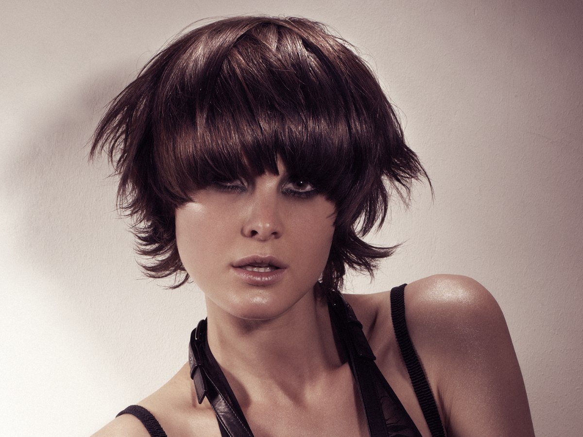 Short Feathered Haircut With Wispy Tips And A Curved Fringe