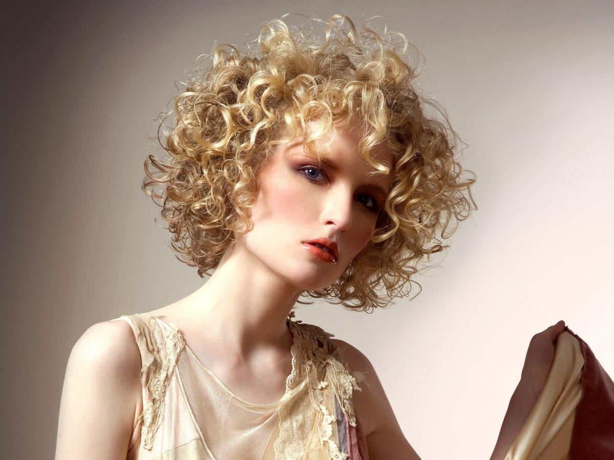 Bob Haircut With Box Layering And A Halo Of Curls