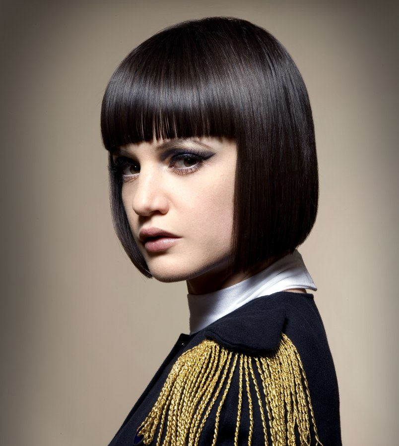 Smooth chin-length bob with a blunt fringe and ends with