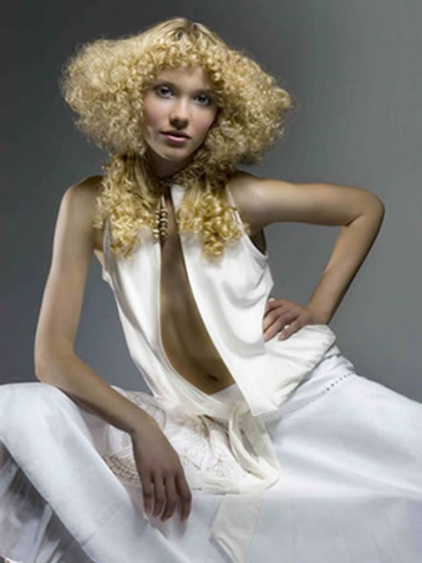 Blonde Hair Set In A Stackwind With Small Perm Rods