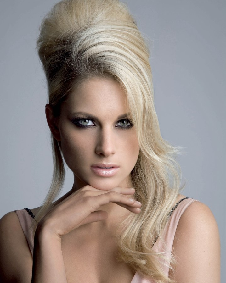 Updo Long Blonde Hair Pinned Into A Beehive Shape