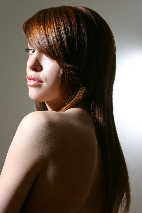 Long Flowing Hair With An Angled And Side Swept Fringe