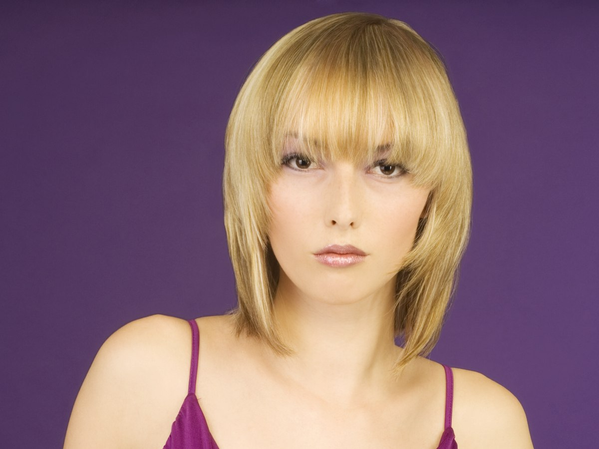 Blonde Medium Length Hairstyle With Soft Contours And