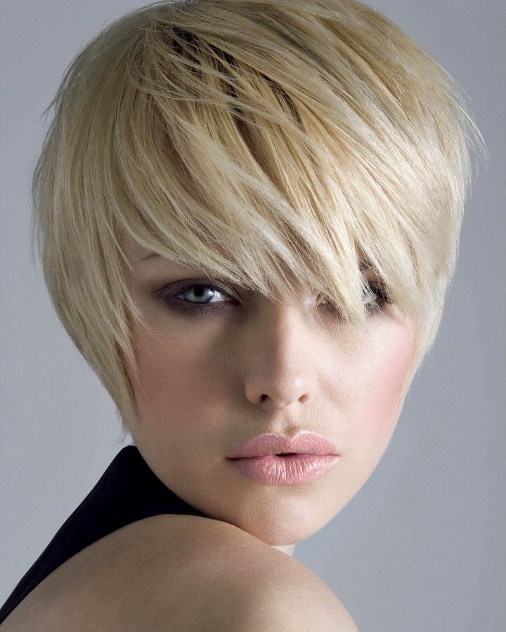Short hairstyle with a lash length fringe  Hair shaped to