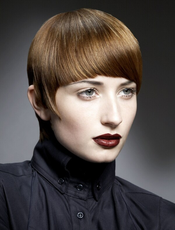 Short haircut with rounded bangs, longer sides and close to the head ...