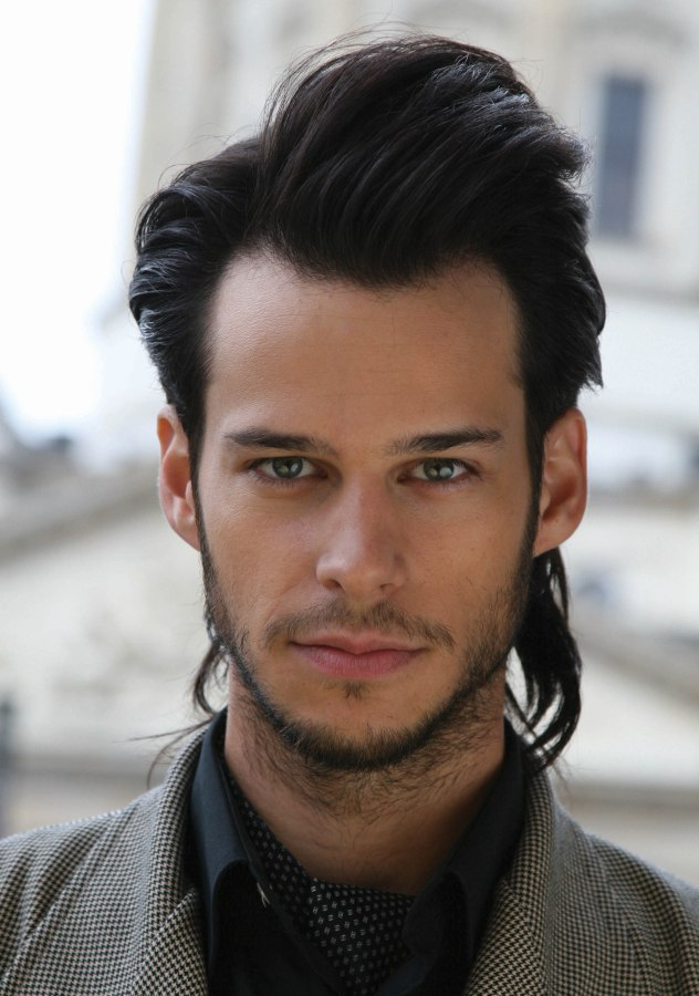 Hairstyle With Long Sideburns For A Young Man
