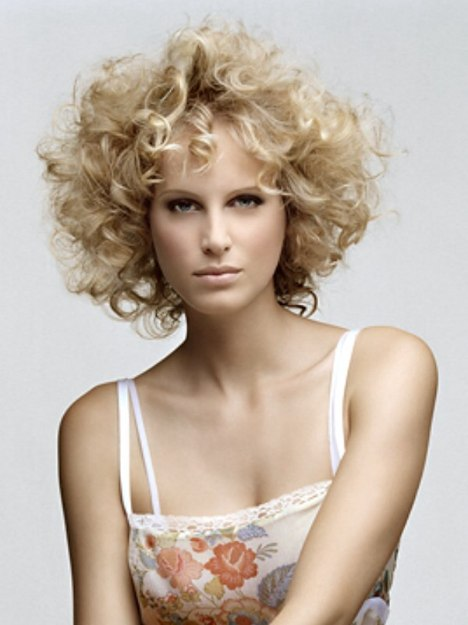 Medium length hair with natural or permed curls
