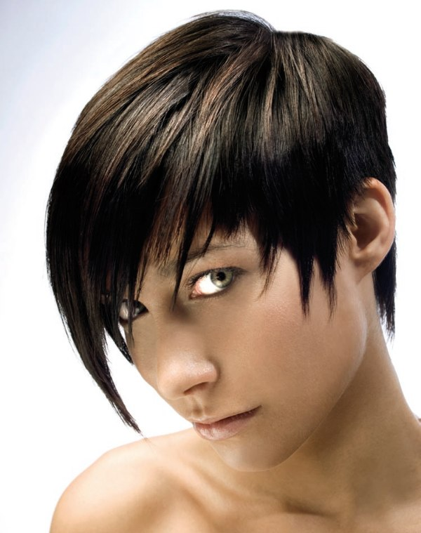Androgynous short woman's haircut with playfull long strands