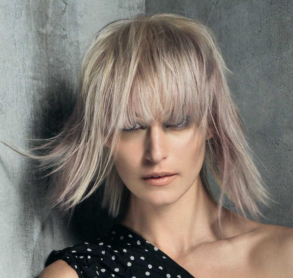 Modern Bob With A Long Layered Fringe And Feathery Sides