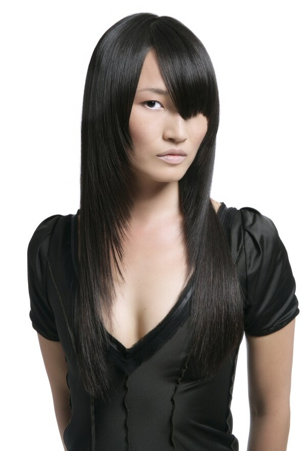 Long Slanty Angled Haircut With A Sharply Edged Top